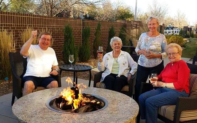 Residents enjoying the fire pit at The Avenues Crofton Park